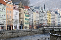 colorful buildings by the river at karlovy vary