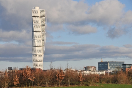 the turning torso building set against the blue sky in Malmo City