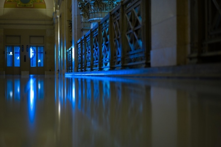 view down the corridor with blue lights: a floor view of the corridor with blue cold light from the windows