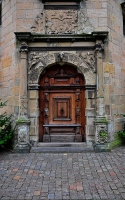 the door to the castle: a medieval wooden door at the Kronborg castle in Denmark
