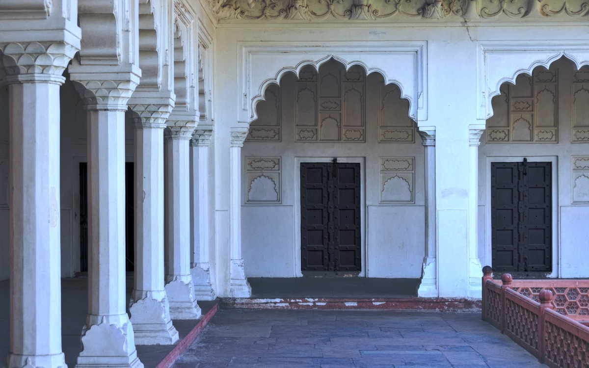 black doors with white walls and pillars
