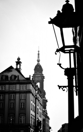 a building, a spire and a street lamp