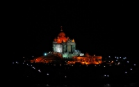 building with lights at night : set in kanyakumari, building with lights at night