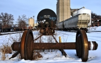 abandoned rail wheels in the snow : rail yard in the snow with abandoned wheel