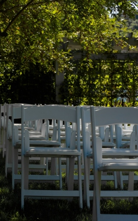 white chairs laid out in a green lawn
