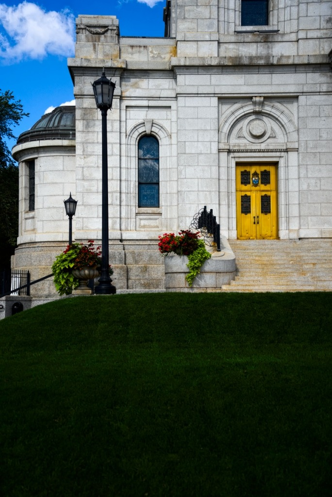 green lawn and the gold door and the basilica